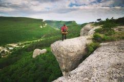 Man tourist in mountain Stock Image