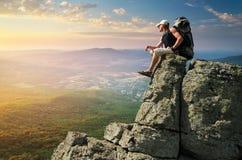 Man tourist in mountain stock photo