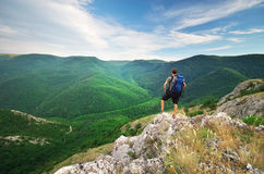 Man tourist in mountain Stock Images