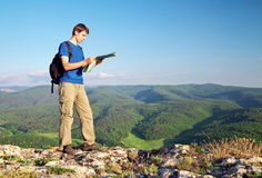 Man tourist in mountain read the map. Royalty Free Stock Photos
