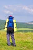 Man tourist in mountains. Royalty Free Stock Photo