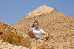 Man tourist by pyramid in Egypt Stock Images