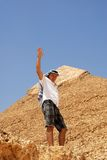 Man tourist by pyramid in Egypt Stock Image
