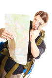 Man tourist reading map with magnifying glass. Stock Photo