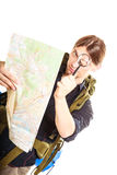 Man tourist reading map with magnifying glass Stock Photography