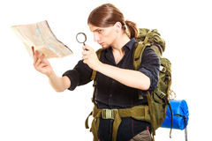 Man tourist reading map with magnifying glass Royalty Free Stock Photo
