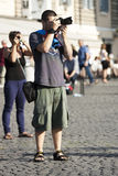 Man tourist with reflex photographing Stock Image