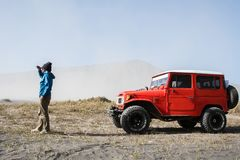 Man tourist on sand dune in desert during off road vehicle on sand, savannah at Bromo Mountain Tengger, East Java, Indonesia stock image