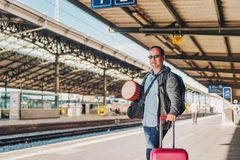 Man tourist standing on a platform. Of a train station Royalty Free Stock Photo