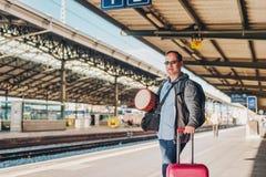 Man tourist standing on a platform Royalty Free Stock Photo