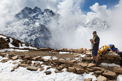 Man tourist standing snow mountain ridge peaks, Nepal. Stock Image