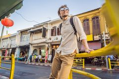 Man tourist on the Street in the Portugese style Romani in Phuket Town. Also called Chinatown or the old town royalty free stock photos