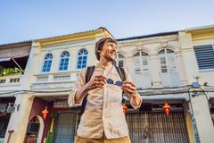 Man tourist on the Street in the Portugese style Romani in Phuket Town. Also called Chinatown or the old town royalty free stock images