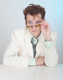 Man with tousled hair sits at a table Stock Photography