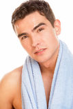 Man with towel. Portrait of young man with towel on neck Royalty Free Stock Images
