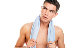 Man with towel. Portrait of young man with towel around neck isolated on white background Stock Image