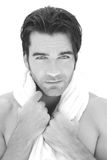 Man with towel. Fresh clean close-up portrait of a young man with towel around his neck against white background royalty free stock images
