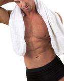 Man with towel. Muscular man wearing shorts and towel royalty free stock photos