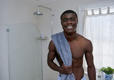 Man towel bathroom portrait. Portrait of handsome african black man standing with towel in home bathroom royalty free stock image