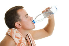 Man with towel drinking water Royalty Free Stock Images