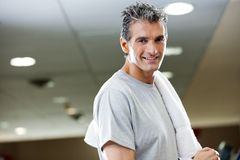 Man With Towel In Health Club Stock Image