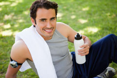 Man with a towel on his shoulder looking upwards holding a sport Stock Images