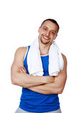 Man with towel standing with arms folded Stock Photography