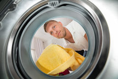 Man With Towel View From Inside The Washing Machine Stock Images