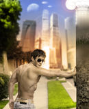 Man about town. Conceptual portrait of a sexy musuclar man against street view background Stock Images
