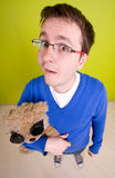 Man and toy-bear. Fish-eye lens royalty free stock photography