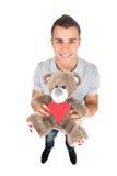 Man with toy bear. Stock Photos