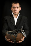 Man with toy bikes in the hands Stock Images
