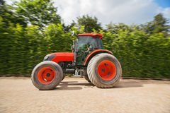 Man with tractor in a garden, blurred motion Stock Photo