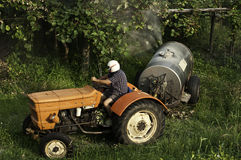 Man on tractor Stock Image