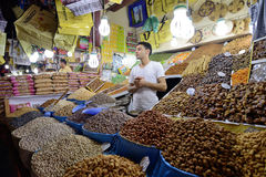 Man trades a dried fruits in a market Royalty Free Stock Image