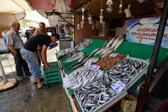 Man trades fish in a market Stock Photos