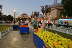 Man trades fruits in a street near Hagia Sofia Stock Images