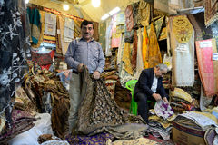 Man trades traditional iranian fabrics Royalty Free Stock Images