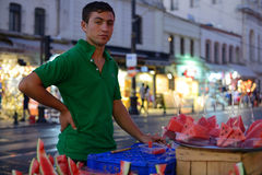 Man trades watermelon in a street Stock Image