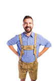 Man in traditional bavarian clothes, hands on hips Royalty Free Stock Photos