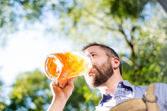 Man in traditional bavarian clothes holding mug of beer Royalty Free Stock Photos