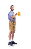 Man in traditional bavarian clothes holding mug of beer Stock Photography