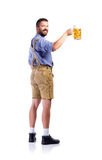 Man in traditional bavarian clothes holding mug of beer Royalty Free Stock Photography