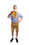 Man in traditional bavarian clothes holding mug of beer Stock Photos