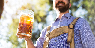 Man in traditional bavarian clothes holding mug of beer Royalty Free Stock Image