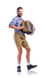 Man in traditional bavarian clothes playing accordion. Oktoberfe Stock Photography
