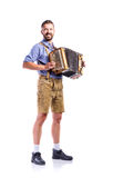 Man in traditional bavarian clothes playing accordion. Oktoberfe Royalty Free Stock Image