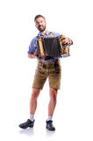 Man in traditional bavarian clothes playing accordion. Oktoberfe Royalty Free Stock Images