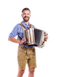 Man in traditional bavarian clothes playing accordion. Oktoberfe Royalty Free Stock Photography