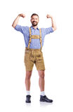 Man in traditional bavarian clothes showing biceps on his arms Royalty Free Stock Images